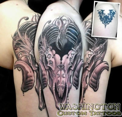 cover up tattoos_tribal bat evil ram skull coverup